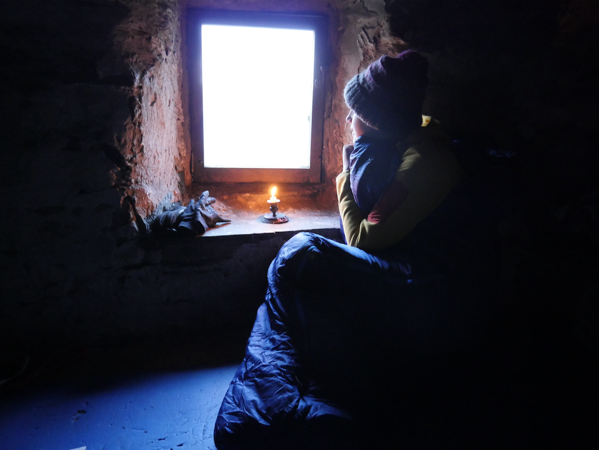 Woman sitting in Warnscale Head bothy, Lake District